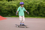 Young boy in action on his skateboard. poster