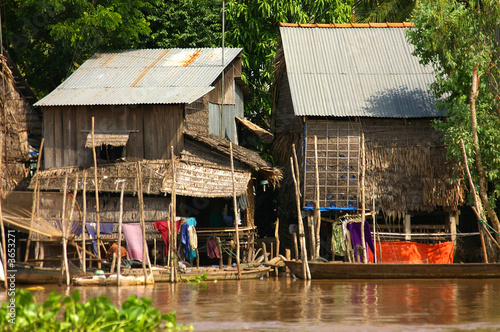 traditional house on stilts in the Mekong delta