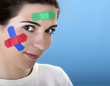Beautiful woman with colored bandages on the face  poster