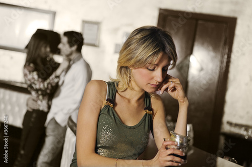 girl alone in a pub