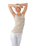 trendy beautiful girl in golden striped t-shirt and white pants poster