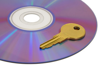 Key on computer cd, isolated on white background