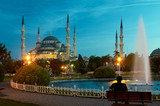 man sitting opposite blue mosque in istanbul in the evening