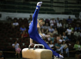 Young man competing on the pommel poster