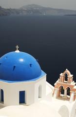 famous greek island church over aegean cruise ship in distance