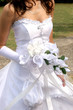 bride in wedding dress and holding bouquet
