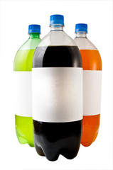 A close up on three soda bottles isolated on a white background.