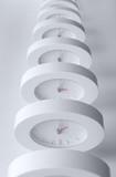 Endless line of equal clocks. poster