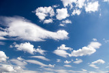 High contrast blue sky with clouds. poster