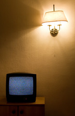 Concept simple interior. Wall, tv and red lamp.