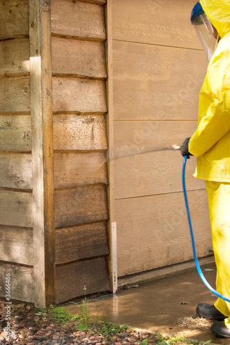 a man doing a chemical wash on a garage
