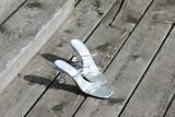 elegant shoes on wood silver high heel strap poster
