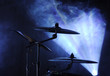 cymbals set in blue light of searchlights