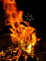 Closeup detail of fire in outdoor BBQ charcoal grill