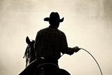 cowboy at the rodeo - shot backlit against dust, added grain poster