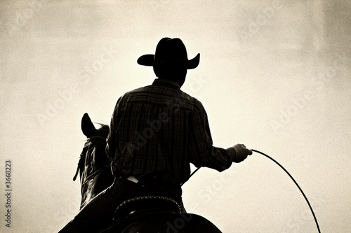 Cowboy At The Rodeo - Shot Backlit Against Dust, Added Grain