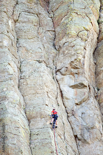 mountain climber on devil's tower, wyoming