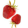 Two strawberry close-up isolated over a white background