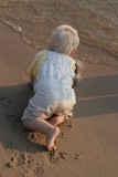 baby boy crawling on beach sand poster