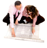 couple planning their house on a blueprint poster