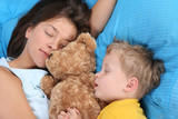 mother and three years old boy sleeping together poster
