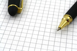 close-up of pen tip and blank squared paper poster