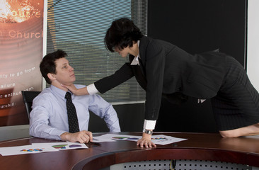 Business workgroup fighting in a boardroom setting
