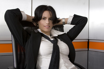 Attractive brunette business woman wearing suit