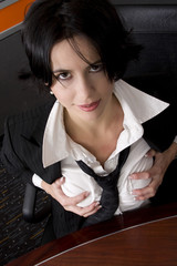 Attractive brunette business woman showing breasts