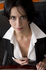 Attractive brunette business woman showing cleavage