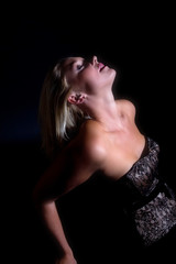 Beautiful blond woman leaning backwards
