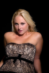 Beautiful blond woman leaning backwards with corset