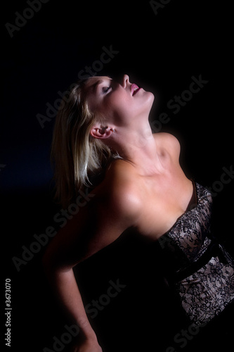 Beautiful blond woman leaning backwards