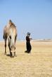 Camel and herdsman