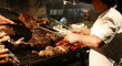 Leinwanddruck Bild - Argentinian chef cooking meat in the restaurant
