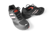 black jogging shoes isolated on white (contains clipping path) poster