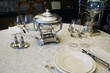 beautiful antique table setting with silver soup bowl