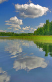 landscape with blye sky, clouds, forest and their reflections poster