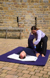Hamstring massage as part of a Thai body massage poster