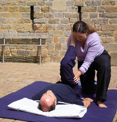 Hamstring stretch as part of a Thai body massage