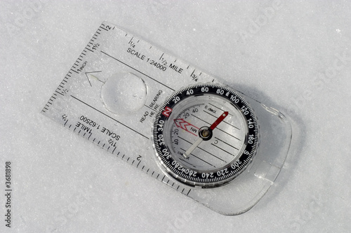 compass in a fresh winter snow