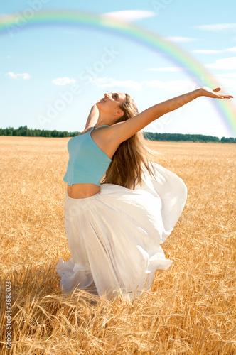 fit girl working out at the field under rainbow
