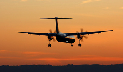 Turboprop Landing At Sunset