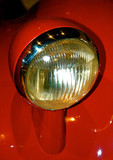 Red automobile headlight poster