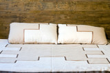 Oold-slyle wooden bed with pillows poster