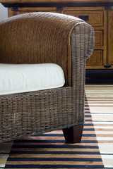 Detail of stylish rattan armchair