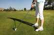 A woman golfer getting ready to swing her club