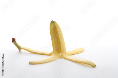 A banana peel over a white background