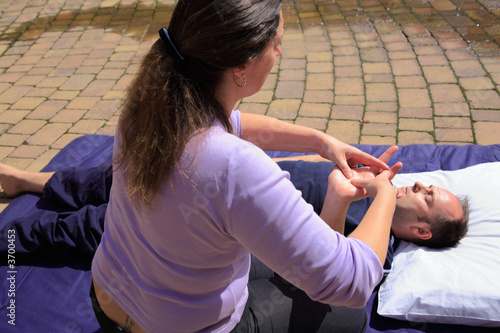 Massage to the palm of the hand as part of a Thai body massage.