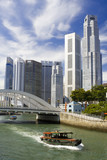 Singapore financial district with river in foreground.. poster